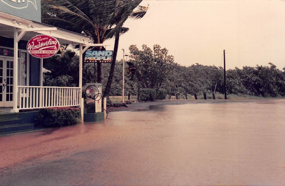 Hanalei Sailboards - Hanalei Sailboards pictured to the left near Sand People and The Dolphin | Circa 1985(Before police would block the road when the town flooded!)