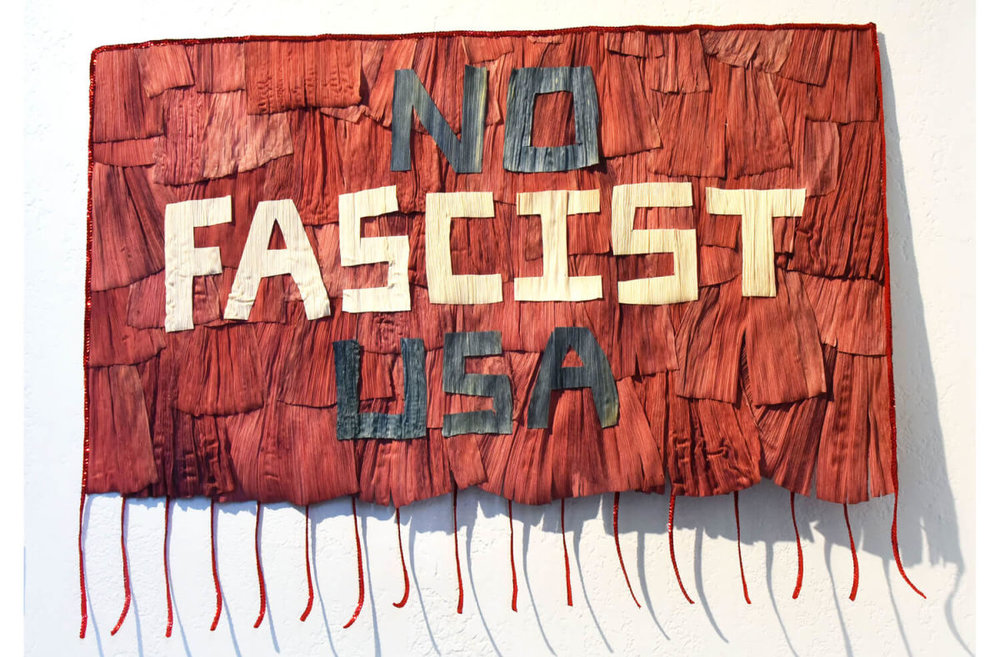 Suzy Gonzalez,  No Fascist USA , corn husks and ribbon