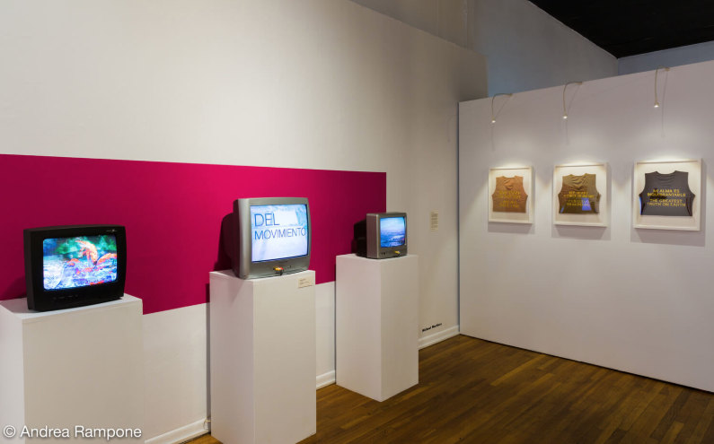 Michael Martinez,  Time Immemorial , Digital video, digital animation, readymade, CRT television sets, 2017 and  Muy Valiente , Nude binders by gc2b Transitional Apparel, readymade, embroidery, poetry, Various dimensions, 2017
