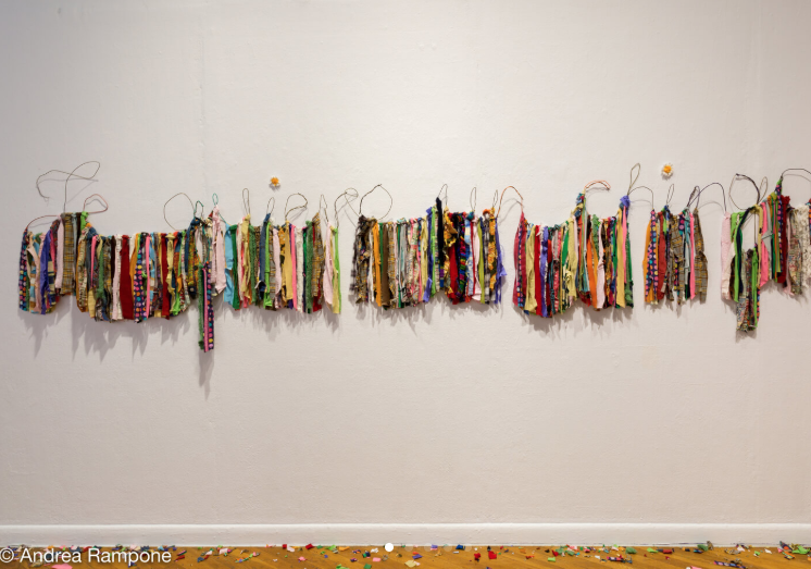 "Daniela Cavazos Madrigal,  I want you a joke (Te quiero un chingo) , Wire hangers, discarded clothing (Ganchos de alambra, ropa usada), 14"" x 144,"" 2017"