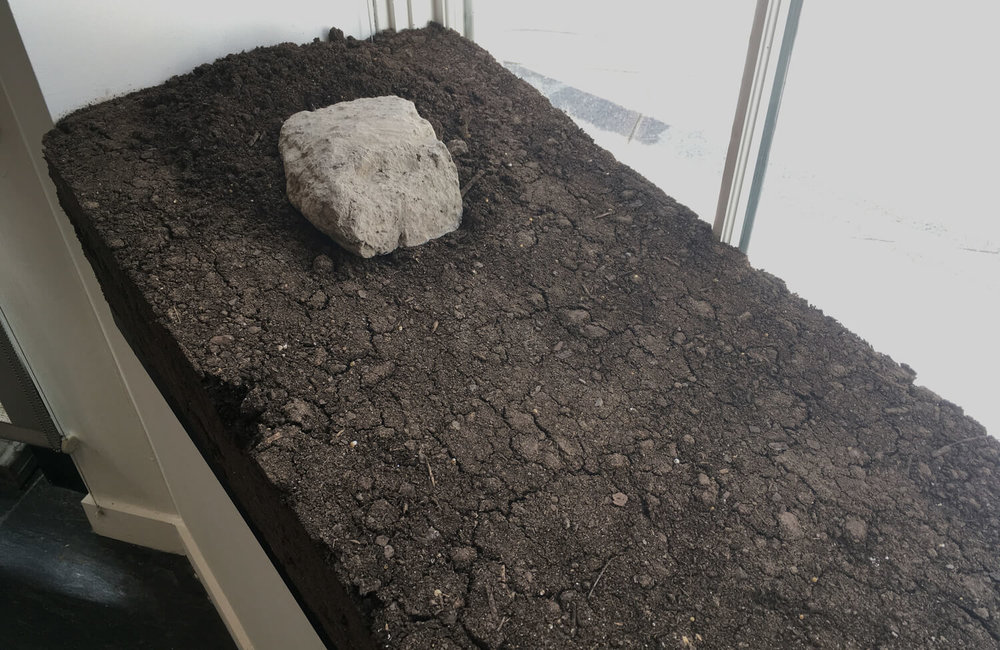 Alva Mooses,  Moving earth / Moviendo tierra , 2017, Removed adobe brick (origin Saltillo, Mexico). Rammed Topsoil platform (from Home Depot, NYC). Permit and authorization documents to receive foreign soil in the U.S.