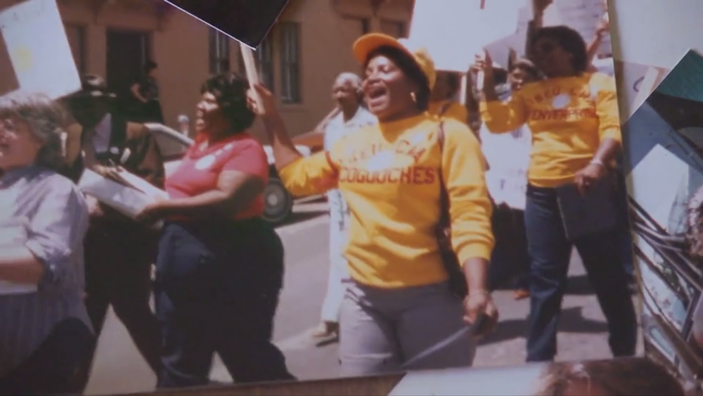 Betty Jean Layton in the Jobs With Justice March. Film Still.