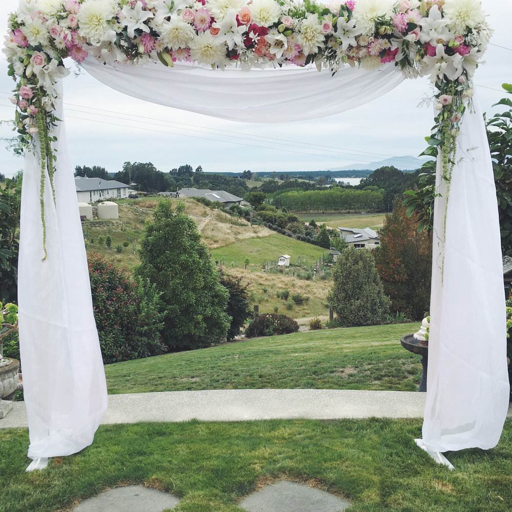 wooden archway w draping.jpg