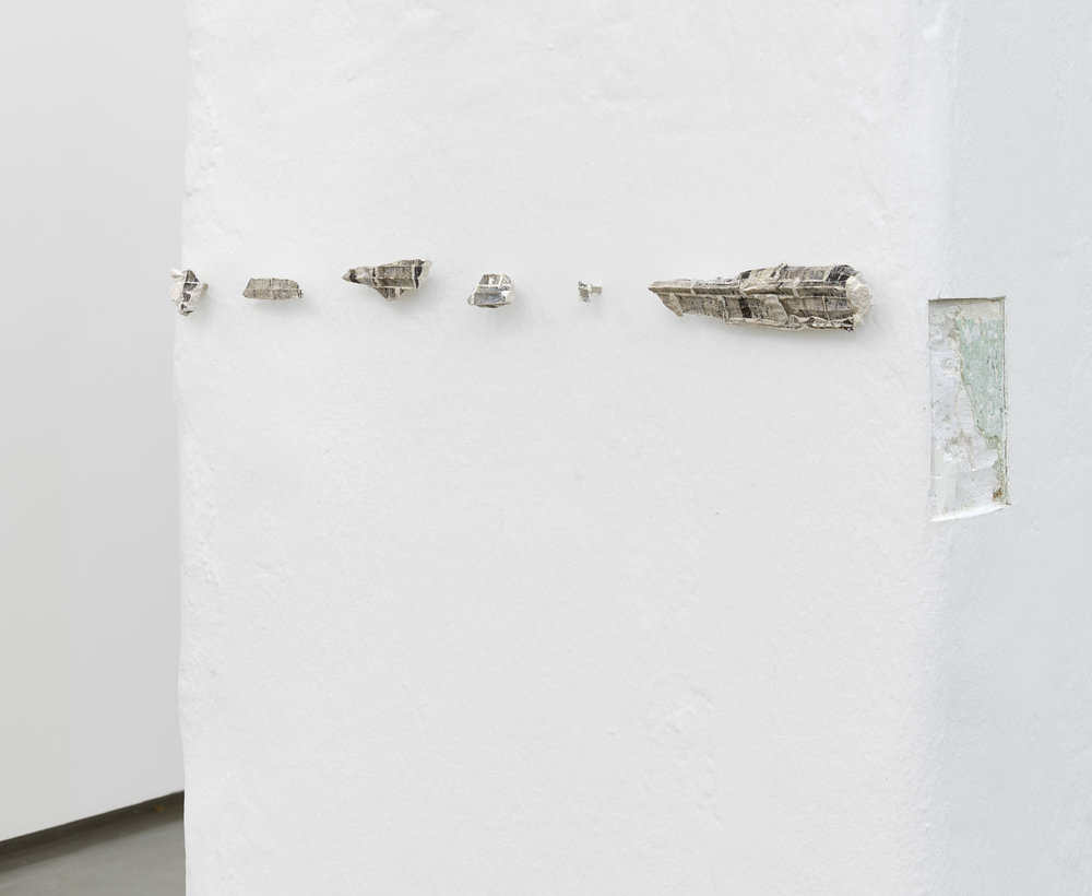 Patterns of a drifting list,  2016  carved wall, plaster and transferred photo  dimensions variable