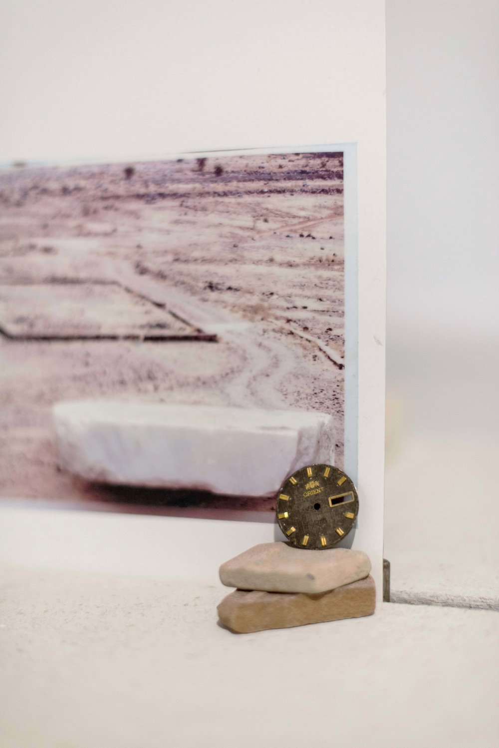 Time in stone (Orient) , 2018  Detail: watch dial, sea tiles, plaster board and inkjet print on paper