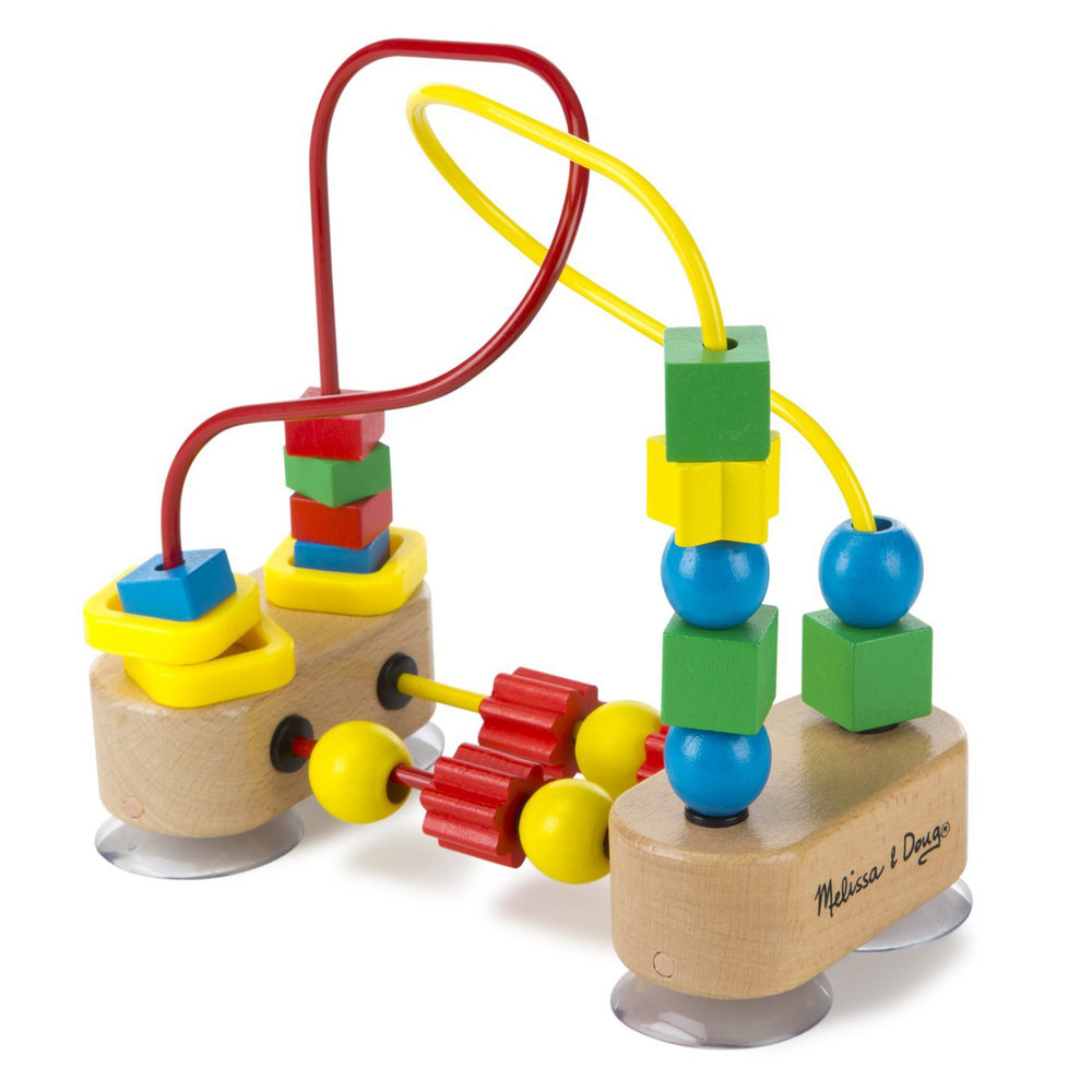 FIRST BEAD MAZE (Melissa & Doug, R235)  Sitting in a high chair is much more fun with this fantastic bead maze, featuring brightly coloured, multi-shaped beads that spin and slide along red and yellow wire pathways anchored by a strong suction cup base.  This high quality educational toy encourages colour recognition, hand-eye coordination and fine motor development through play!  Suitable for ages 12 months and older.