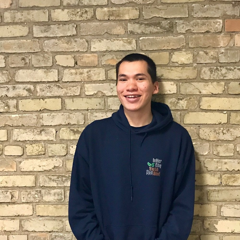 """Ronald first got involved with ICYA when he began volunteering in 2016. He has lived in Winnipeg's North End for most of his life. Once he discovered ICYA, he was quite surprised by the work that ICYA did for his community. Through his time volunteering he discovered his passion for working with kids and youth. Ronald gives credit to God for opening and closing many doors on his journey to ICYA. Ronald says, """"that God has made my calling in life quite clear to me."""" When Ronald is not here at ICYA, he loves to spend time with friends and family. He also loves to learn new things and create new experiences, including hands-on learning or diving into a book. He especially loves learning about history and studying the Word of God."""
