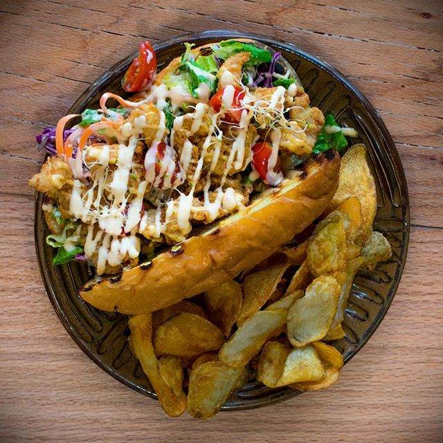 This week's special: a mouthwatering Shrimp Po Boy. Crispy fried shrimp, creamy dressing, and bright, fresh slaw on a buttery bun. Here for a limited time only, so grab one while you can!  #droolworthy #instagood #instaeats #awesomesauce #shrimp #poboy #southerncooking #chefdriven #comfortfood #awesomealpharetta #alpharettaears #atlantaeats #goodfood
