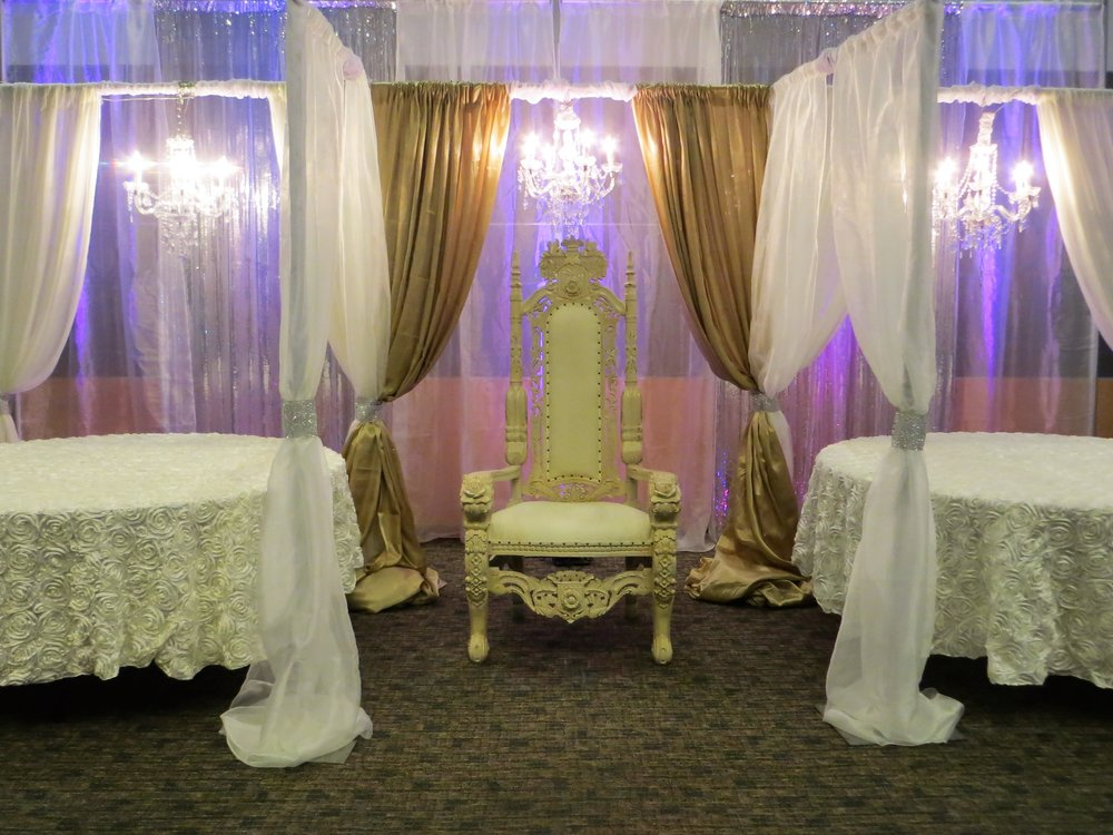Royal chair with backdrop and tables.JPG