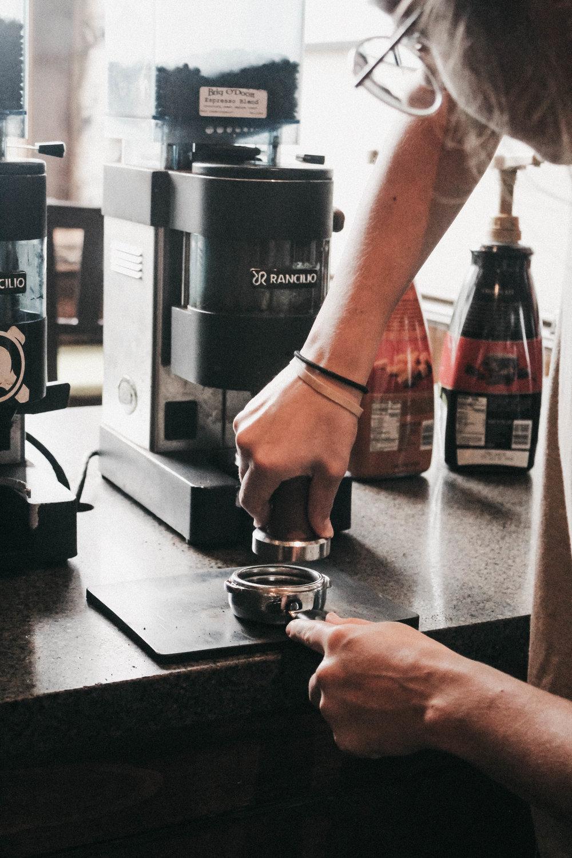 brigodoon coffeehouse tamping espresso.jpg