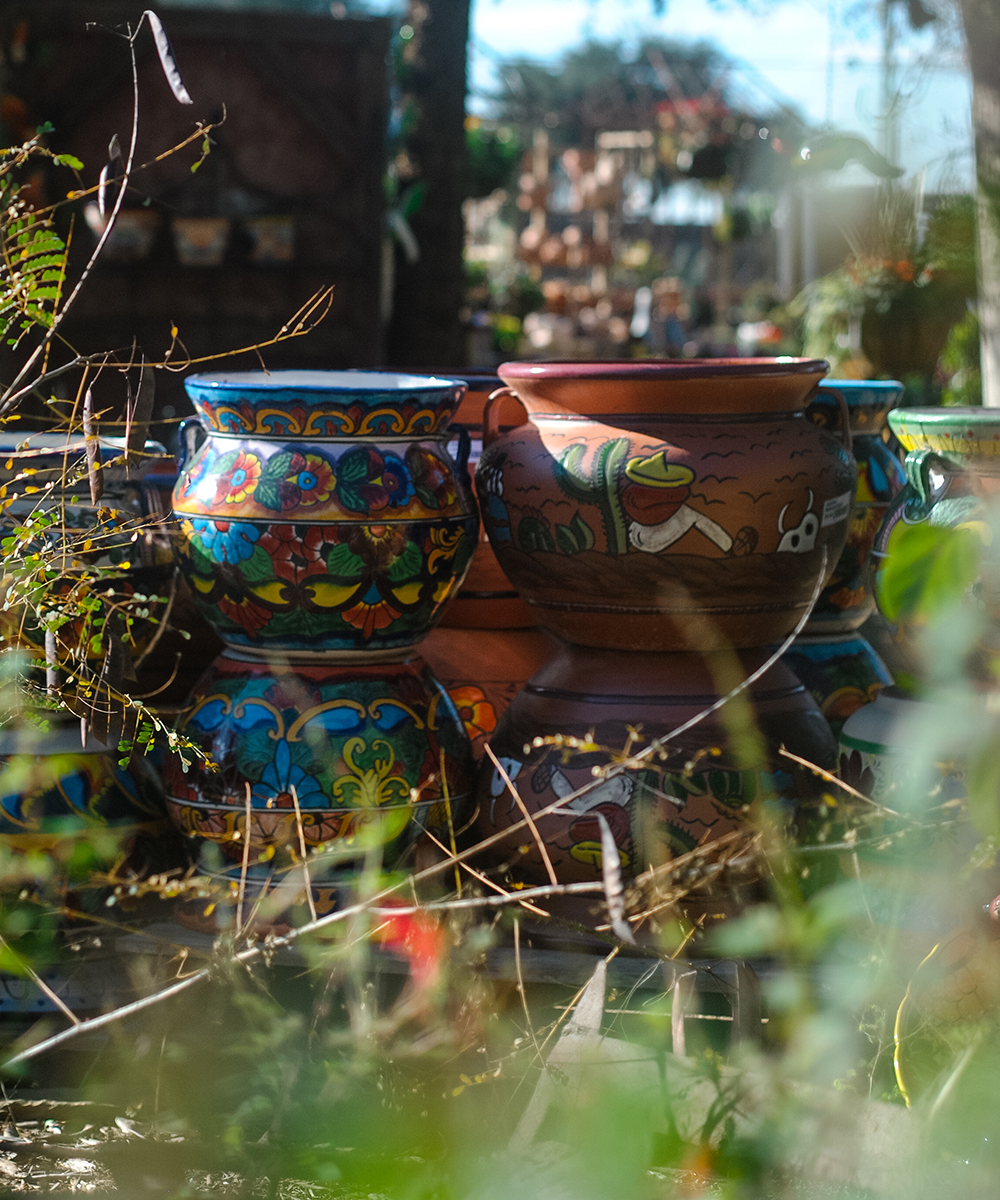 Pictured above are two styles of hand-made Talavera Mexican pottery displayed together at  Enchanted Gardens . Our buying staff hand-picks the Talavera out of a wide selection with our customers and local culture in mind. They look for familiar signatures of our favorite artists as well as keep an eye out for new gems.