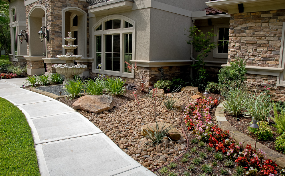 A low maintenance xeriscape for a grand house and property.