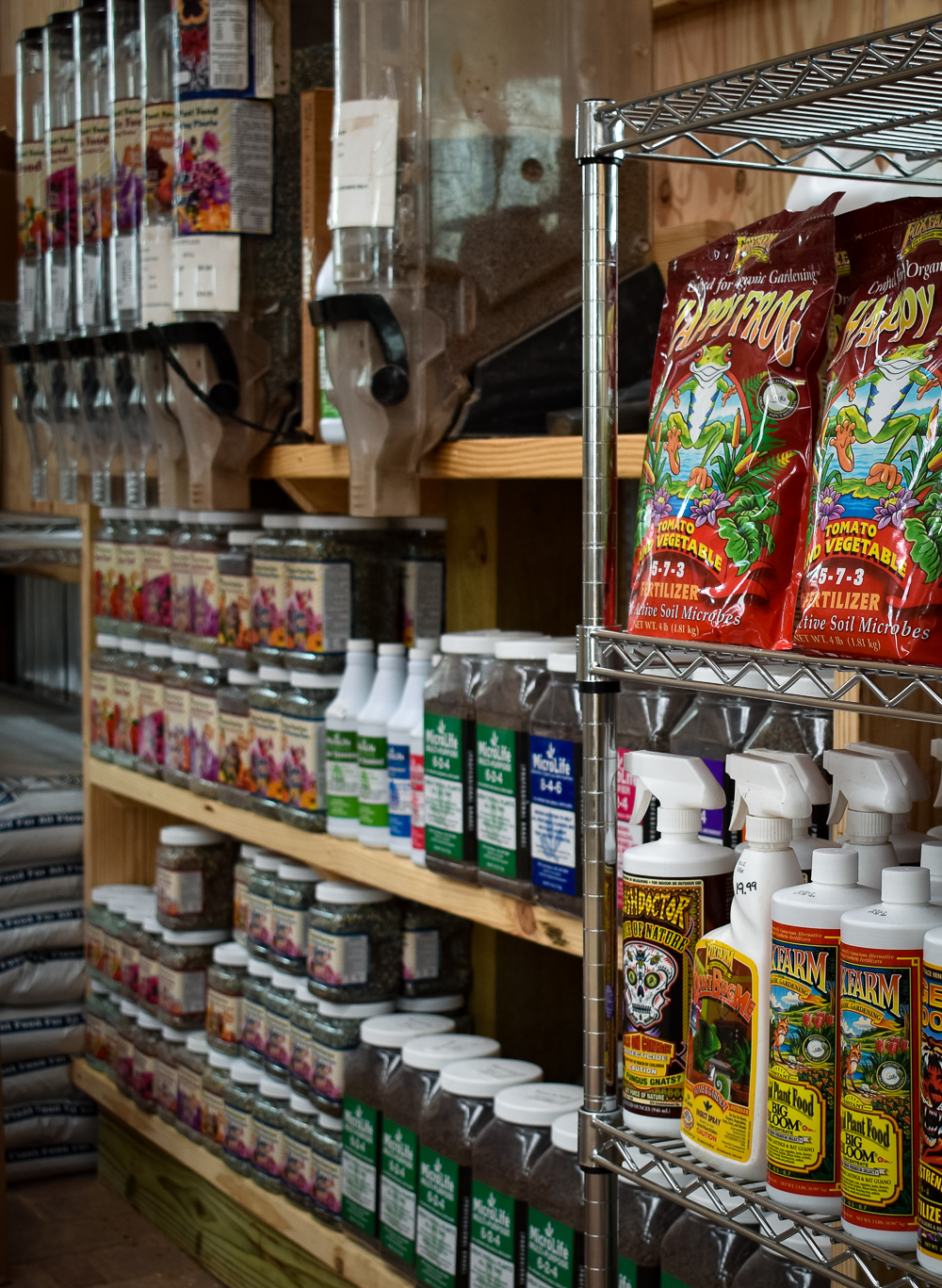 Organized shelves of fertilizers to suit all kinds of specific needs at Enchanted Forest.