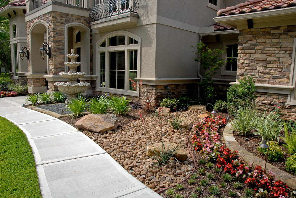 view our portfolio - View past projects from the 20+ year history of Enchanted Landscapes. They include outdoor structures, flowerscapes, xeriscapes, pathways, and more!