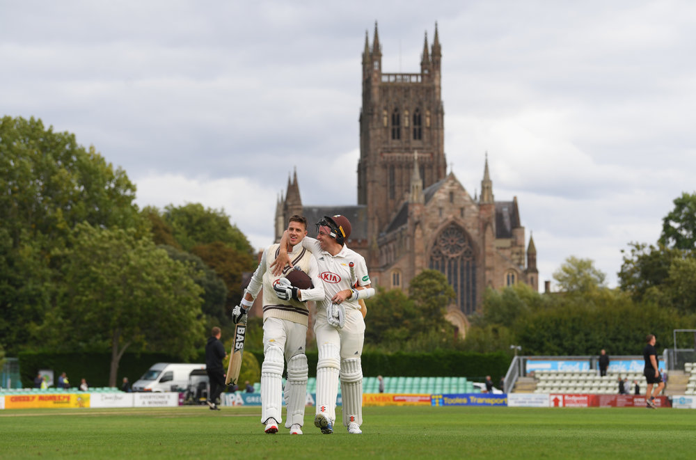 Morne Morkel and Rikki Clarke leave the field of play at New Road, Worcester having scored the winning runs to confirm Surrey's 20th County Championship Title.