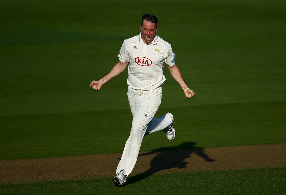 Rikki Clarke celebrates dismissing Lewis McManus during day one of the match between Surrey and Hampshire at the Kia Oval.