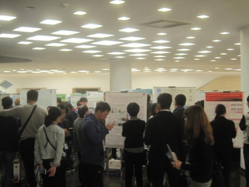 Participants enjoy a poster session at GSBC2.                                Photo credit E.Bach