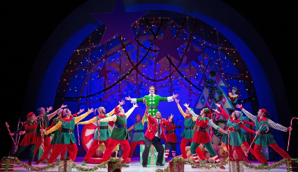 Elf at Paper Mill Playhouse; Photo by Matthew Murphy; James Moye (Buddy) and DeMone (Macy's Manager), center, and the company of Elf. ELF Photo 3: Elf at Paper