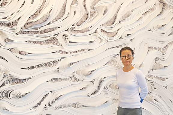 Artist Jae Ko and detail from Selections, Force of Nature, 白 Shiro, 2015, recycled Kraft paper, dimensions variable, Courtesy of the Artist