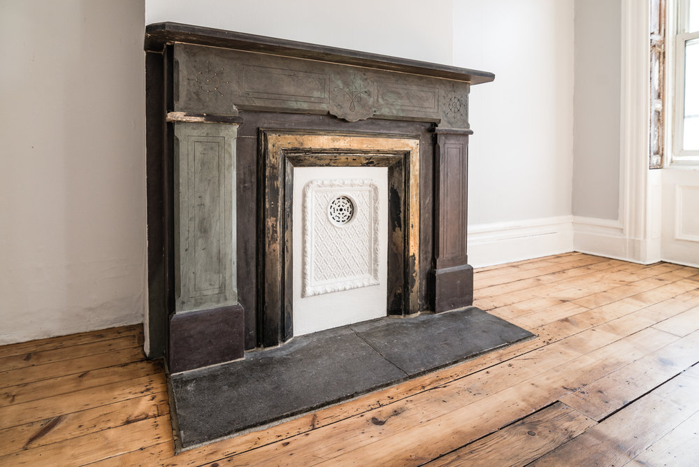 Original fireplace and gorgeous wide plank wood flooring, Jersey City Heights.