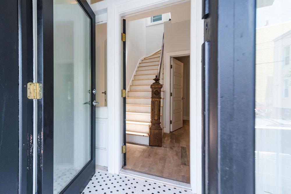 Entry detail, hex tile floor.