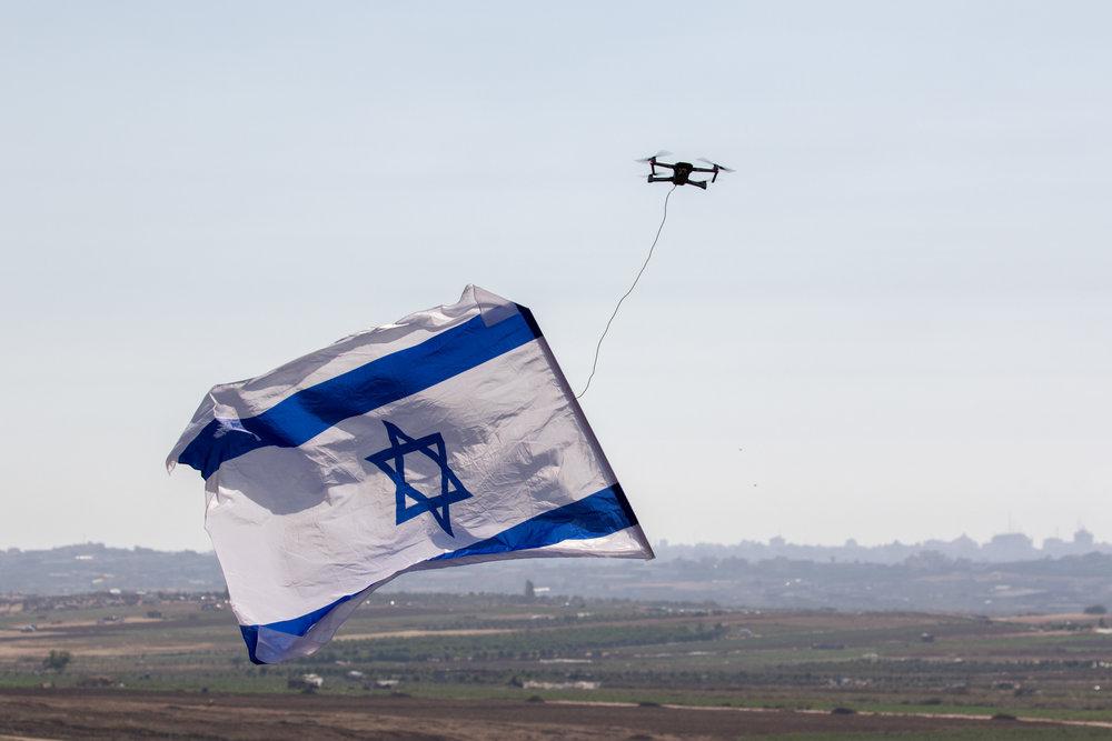Northern Gaza Border, June 2018 - Small drone carries the israeli flag, sent by Israelis leaving near the gaza border