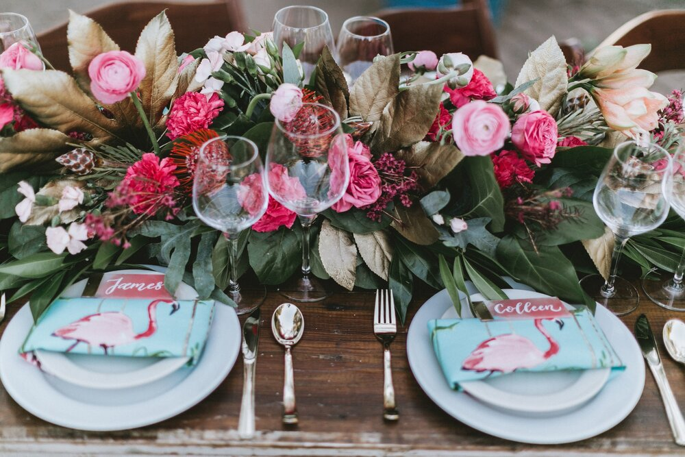 Bright pink florals are the perfect pair for this flamingo themed zoo wedding.