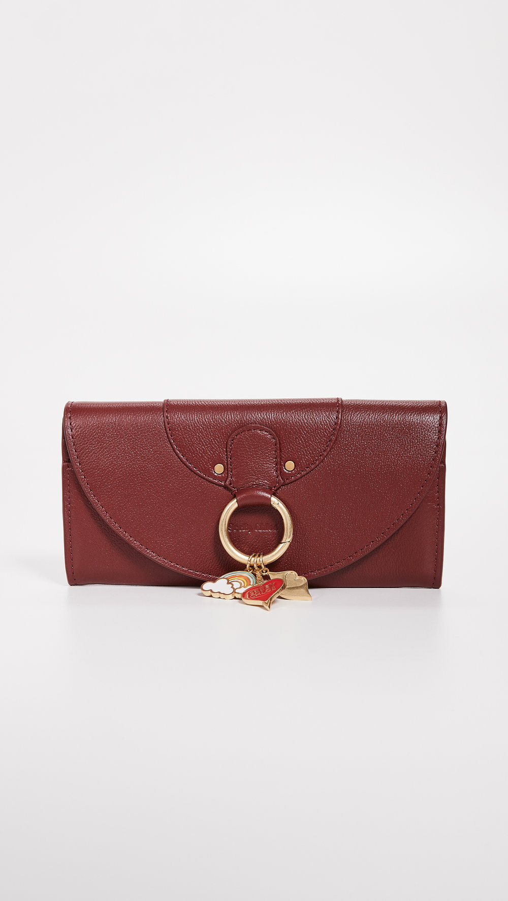 SEE BY CHLOE WALLET - The shade of this wallet is classic, perfect for someone who just likes to carry their wallet or always has a big purse! Also, who could pass up those cute little charms???