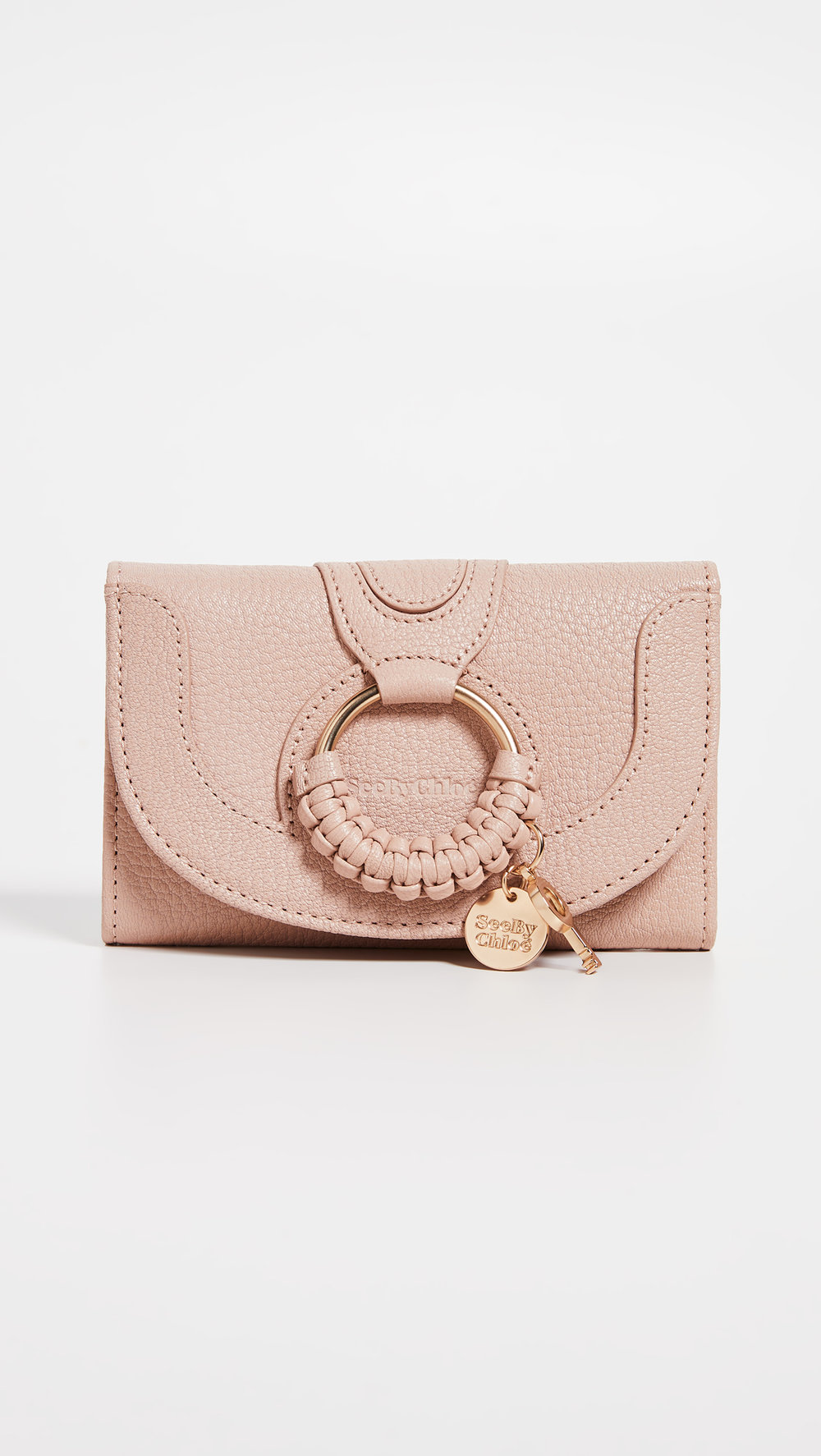 SEE BY CHLOE COMPACT WALLET - I can't even tell you how many times i've lost credit cards/cash because I didn't have a wallet. This little one is the perfect size for your everyday run arounds!