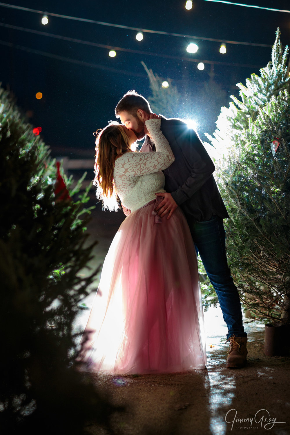 - This shot is one of my favorites from the session. The string lights, backlight, Christmas trees, and of course Lyssa's lovely outfit all come together to complete this shot.