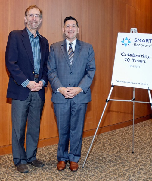 Former Director of the White House Office of National Drug Control Policy, Michael Bottecelli (right), presents an endorsement certificate to SMART Recovery USA board member, Tom Horvath at the SMART Recovery USA 20th Anniversary Conference in Washington. D.C., September 2015.