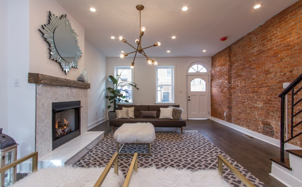 - CHALLENGE Stairs run along the party wall - the main traffic flow between the front door and the rest of the home.SOLUTION Use that party wall to expose those century-and-a-quarter-old bricks to add drama and patina to the room.