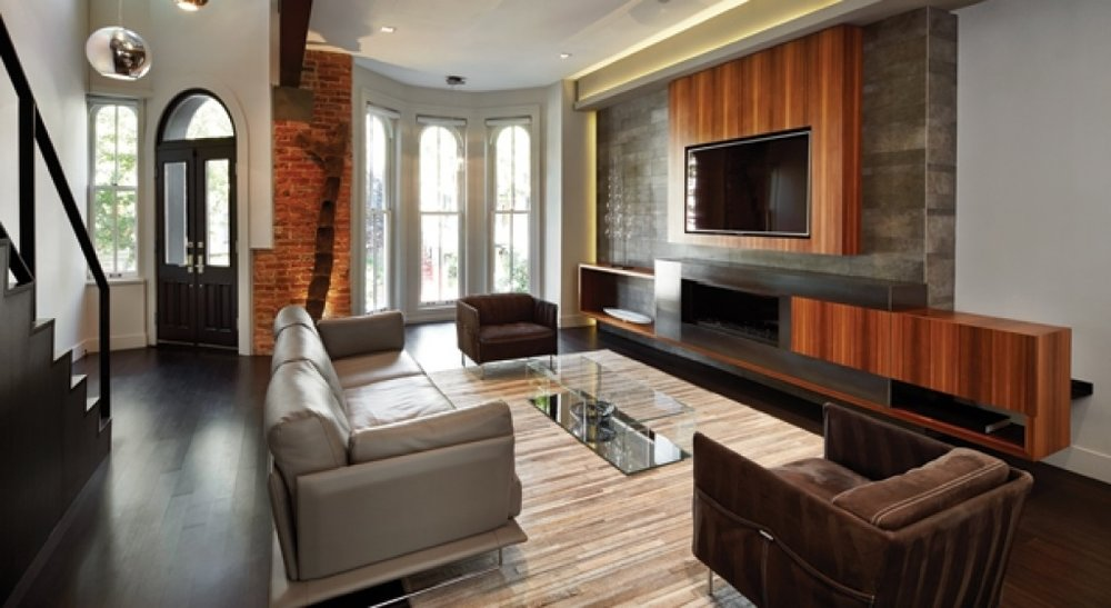 - CHALLENGE Often, there is a bricked up or non-working fireplace in the middle of the long wall.SOLUTION Make it go away with a sleek feature entertainment area – row home meets modern!