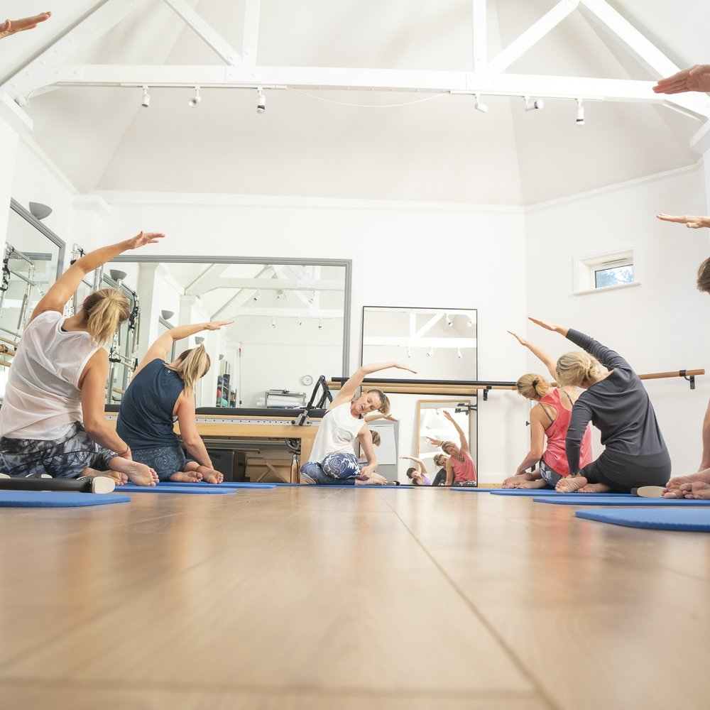 Pilates class using small equipment and the reformer.