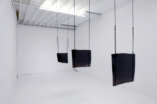 Existere at the Son Gallery, Installation photographs of hand blown sheets of black glass suspended from gallery ceilings, Son Gallery, 2011