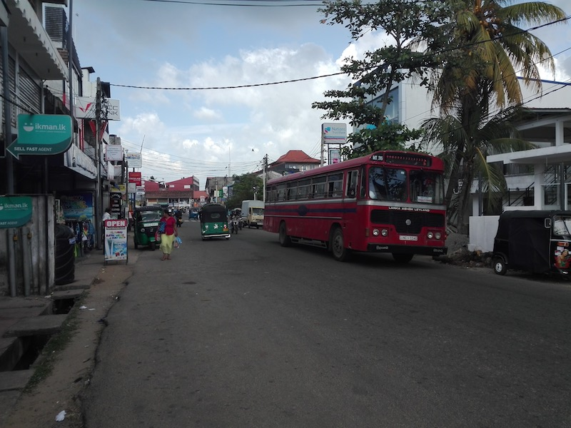 For many visitors, this is the most important street in Weligama with ATMs, the bus station and a wine shop. Photo © Szilvia Molnár