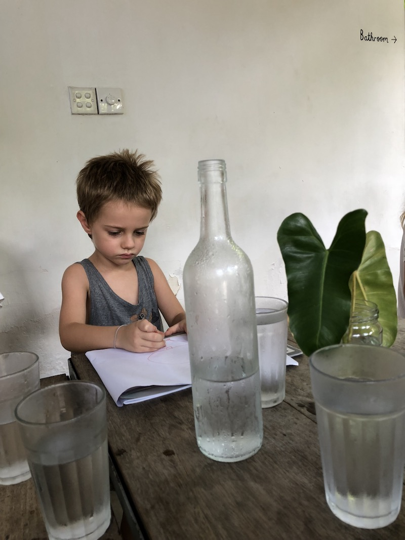 In the flow. Karsa, drawing at Ceylon Sliders, while waiting for breakfast. Photo © Szilvia Molnár