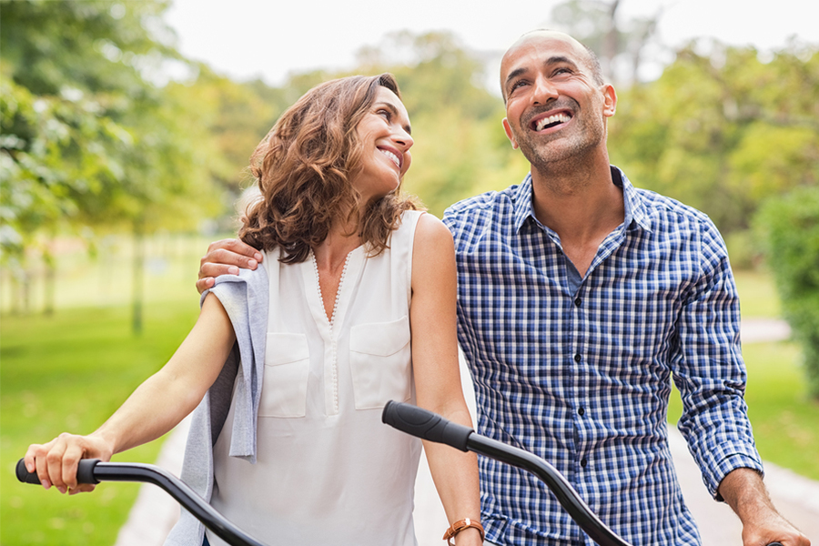 couple smiling and riding bikes together