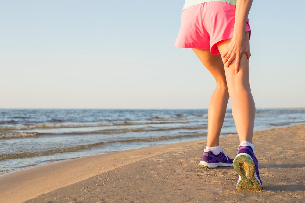 Female runner with pulled hamstring.jpg