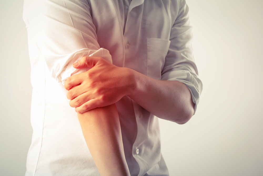 pain in the elbow of a man.jpg