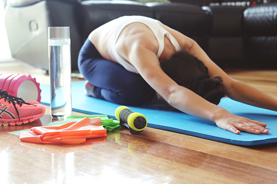 girl stretching on yoga mat