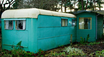 Findhorn's original caravan with built-on shed: a humble beginning for a world-renowned eco community and training center