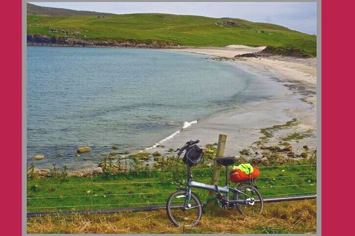 My folding Dahon - stopped for a lunch break at a gorgeous beach - but too cold for swimming!