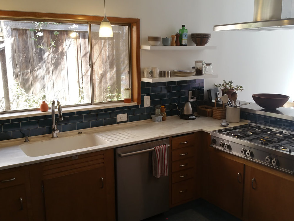 Floating shelves, modern style range  & new back splash give this kitchen a much needed facelift