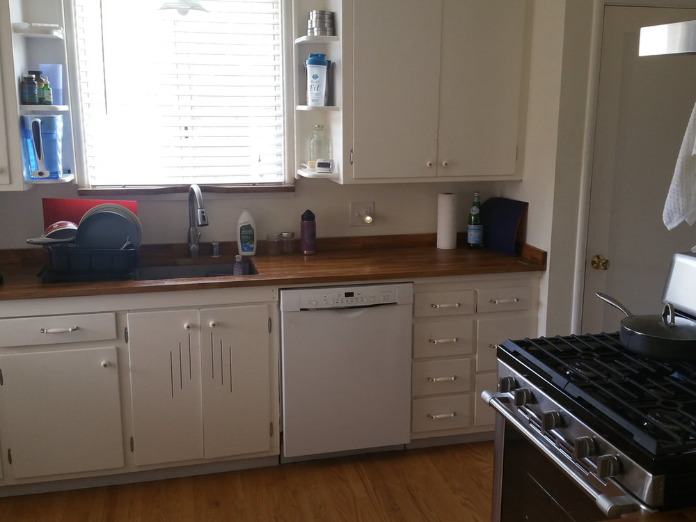 95 y.o. house gets new counter top with large basin sink, dishwasher & modern stove range.