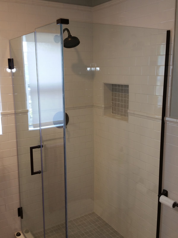 Frame-less shower walls show off the tile surround.