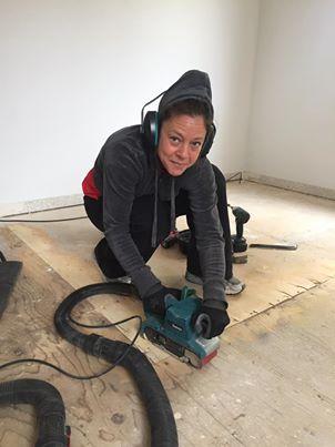 Sanding the floor smooth & level.