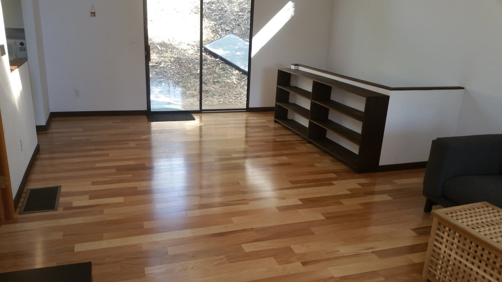 Beautiful floor w/ shelf wall provides access for new stairwell to downstairs garage.