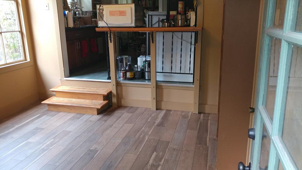 Flood damaged room gets new floor in rental property.