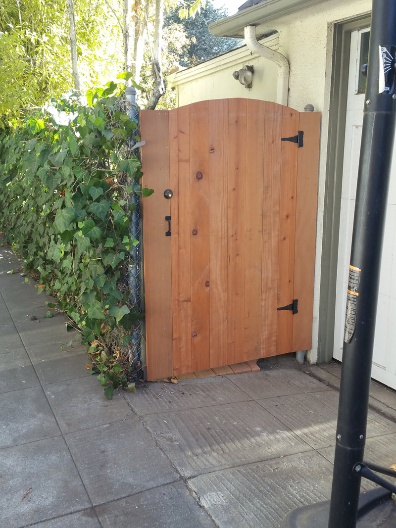 Garbage cans out of sight & deadbolt ensures secure backyard.
